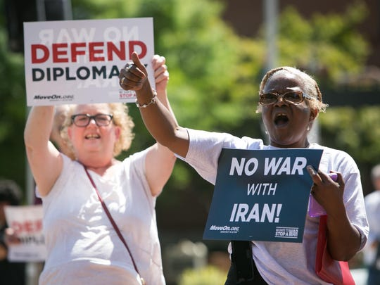 Wanda Thomas (right) of Wilmington and Amy Redman (left) of Wilmington join other protestors as they rally in Wilmington in front of Sen. Tom Carper's office on 3rd and North Market streets as well as Rodney Square pressuring our congressional members to support the Iran deal.