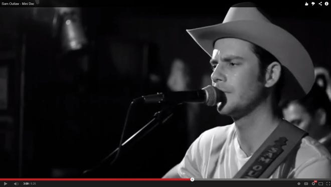 Stagecoach artist Sam Outlaw is seen in a screenshot of a mini-documentary he posted to YouTube.