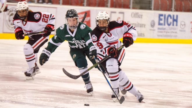 St. Cloud State's Payge Pena (19) tries to win a race to the puck against Bemidji State with Huskies teammate Kayla Friesen (22) in pursuit. St. Cloud State defeated Bemidji State 5-2 in a WCHA women's hockey game Friday at the Herb Brooks National Hockey Center.