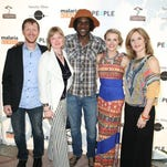 """Burton and Stephanie Ritchie of Heretic Films (left), """"Tanzania: A Journey Within"""" subjects Venance Ndibalema and Kristen Kenney and the film's director Sylvia Caminer pose for photographs at the film's Los Angeles premiere."""