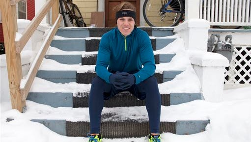 """In this Jan. 2, 2014 photo, Barclay Oudersluys sits on the porch of his home in Ann Arbor, Mich. Oudersluys is planning a coast-to-coast run over 100 days that's similar to part of one taken by Tom Hanks' character in the movie """"Forrest Gump."""" He plans to start the 3,200-mile run he's calling """"Project Gump"""" on Saturday, May 9, 2015 from California's Santa Monica Pier en route to Marshall Point Lighthouse in Maine.  Oudersluys wants to raise $10,000 for the nonprofit Hall STEPS Foundation, which aims to fight global poverty.  (Patrick Record/The Ann Arbor News via AP) LOCAL TELEVISION OUT; LOCAL INTERNET OUT"""