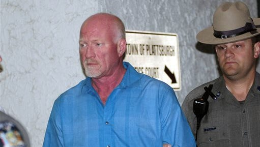 A New York State Police officer escorts suspended Clinton Correctional Facility guard Gene Palmer, left, from Plattsburgh Town Court in Plattsburgh, N.Y., Wednesday, June 24, 2015.  Palmer is believed to have delivered tools inside frozen meat to two Clinton Correctional Facility inmates before they escaped on June 6.  He faces charges including promoting prison contraband and tampering with physical evidence, state police said.  (Rob Fountain/The Press-Republican via AP)