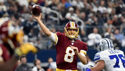 Washington Redskins quarterback Kirk Cousins (8) looks to throw a pass under pressure from Dallas Cowboys defensive end Greg Hardy (76) in the first half of an NFL football game, Sunday.
