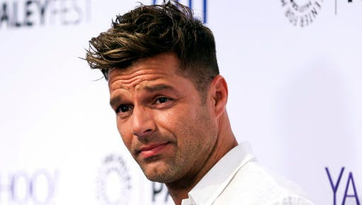 FILE - In this Sept. 10, 2015 file photo, Ricky Martin arrives at the at 2015 PaleyFest Fall TV Previews in Beverly Hills, Calif. Martin said he recently proposed to conceptual artist Jwan Yosef, whom he met a year ago after becoming a fan of Yosef's work. This is the first marriage for each.