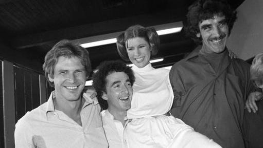 FILE - In this Oct. 5, 1978 photo, from left, actors Harrison Ford, Anthony Daniels, Carrie Fisher and Peter Mayhew take a break from filming a television special in Los Angeles to be telecast during the holidays. On Tuesday, Dec. 27, 2016, a publicist says Fisher has died at the age of 60.