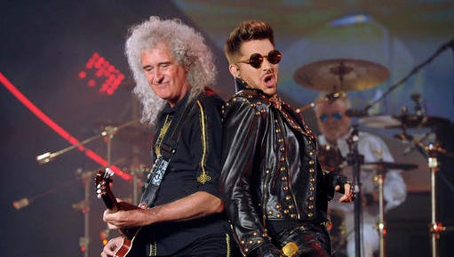 """FILE - In this July 3, 2014 file photo Brian May of Queen, left, and Adam Lambert perform in Los Angeles. Queen has clearly found somebody to love in Lambert. Since joining forces with the """"American Idol"""" runner-up for a series of shows in 2012, the band that ruled rock radio in the 1970s and early '80s has enjoyed tremendous success, with audiences embracing Lambert as the heir to Freddie Mercury's onstage legacy. They've been selling out areas around the world for five years now, and have just announced a 25-city North American tour beginning June 23, 2017, in Phoenix."""