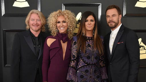"""FILE - This Feb. 12, 2017 file photo shows Philip Sweet, from left, Kimberly Schlapman, Karen Fairchild, and Jimi Westbrook of the musical group Little Big Town at the 59th annual Grammy Awards in Los Angeles. The Grammy winning four-piece country group are returning to their roots with their latest record, """"The Breaker,"""" out on Friday."""