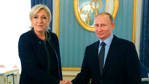 Russian President Vladimir Putin, right, shakes hands with French far-right presidential candidate Marine Le Pen, in the Kremlin in Moscow, Russia, Friday, March 24, 2017. Le Pen has made multiple visits to Russia, as have her father, niece and other members of the National Front, often meeting with Russian legislators.