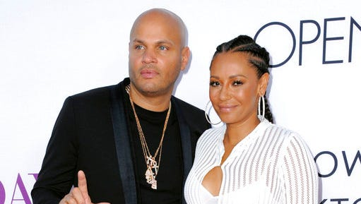 """FILE - In this April 13, 2016 file photo, Stephen Belafonte, left, and his wife Melanie Brown arrive at the Los Angeles premiere of """"Mother's Day."""" A judge has granted singer Mel B a temporary restraining order and sole custody of her youngest daughter after she claimed her estranged husband subjected her to years of abuse.  Court records in Los Angeles show the singer and """"America's Got Talent"""" judge filed for divorce from Belafonte, her husband of nearly 10 years,on March 20, 2017."""
