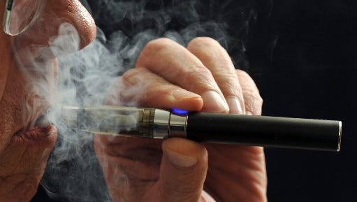 Gov. Rick Snyder vetoed legislation to ban the sale and use of e-cigarettes to minors, saying he wants a tougher laws that treat the devices like regular cigarettes.