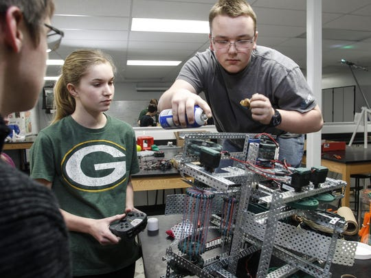Pictured are members of the Haslett High School robotics team. The schools are a major draw for homeowners.