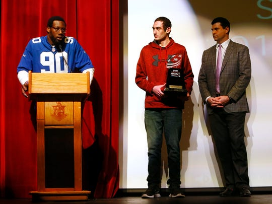 New York Giants defensive end Jason Pierre-Paul talks about USA Football's Heart of a Giant award winner, Mendham junior lineman Sebastian Quinn, as Dr. Samuel Tayor looks on.   Quinn, who was twice diagnosed with ALCL non-Hodgkin's lymphoma, was granted $5,000 for the Mendham football program and will be honored on the field during the Giants' home game against Philadelphia on Sunday. December 12, 2017. Mendham, New Jersey