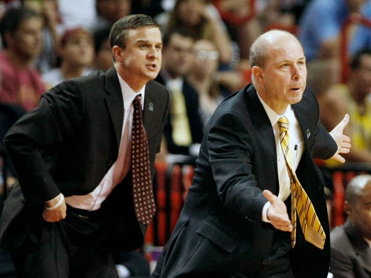 Arizona State head coach Herb Sendek, right, and assistant