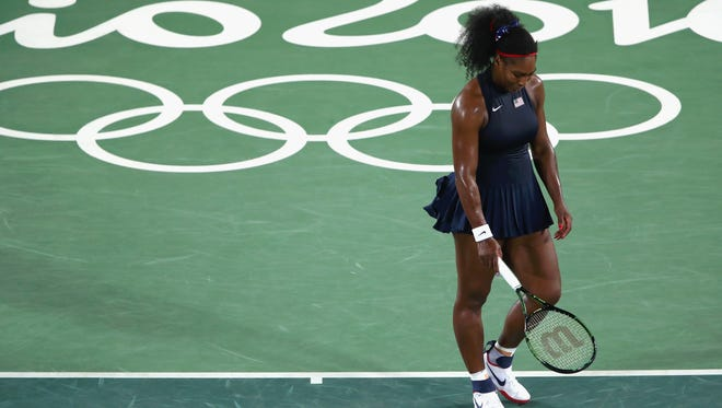 Serena Williams exited the Olympics women's singles tennis tournament with a straight-set loss Tuesday.