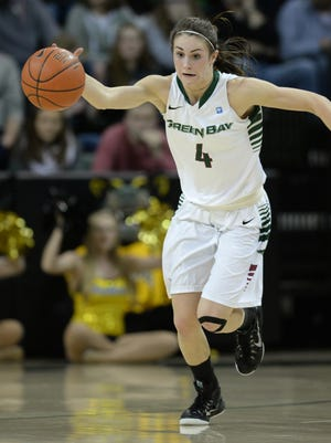 UWGB guard Kaili Lukan (4) steals the ball and heads up court against UW-Milwaukee at the Kress Center March 11, 2015.