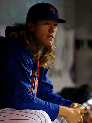 Starting pitcher Noah Syndergaard (34) looks on against the Miami Marlins during the fifth inning at Citi Field on Saturday, May 6, 2017.