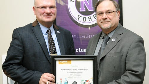 Northern York County Superintendent Eric Eshbach (left) is resigning effective June 4, after accepting a position with the Pennsylvania Principals Association. Eshbach, pictured above with the district's music department chairman Joe Nebistinsky, is holding a Best Communities for Music Education designation from the NAMM Foundation. The award is given to districts that demonstrate outstanding achievement in efforts to provide music access and education to all students.