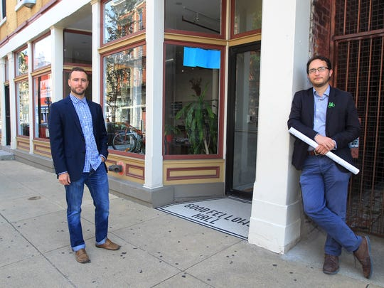 Blake Bartley (left), senior real estate executive, and John Yung, senior project executive, Urban Fast Forward outside the company's Over-the-Rhine office.