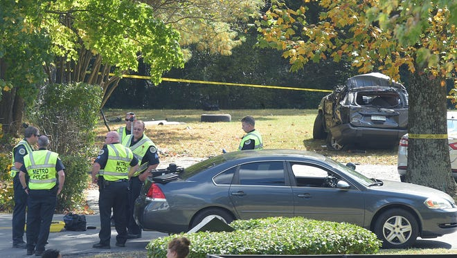 Police investigate a car accident in the Beverly Heights neighborhood on Monday Oct. 17, 2016.