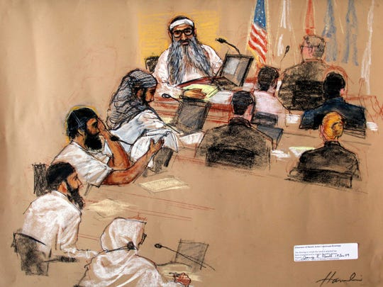 FILE - In this Monday, Jan. 19, 2009 file photo of a sketch by courtroom artist Janet Hamlin, reviewed by the U.S. Military, the five Sept. 11, 2001 attack co-defendants sit during a hearing at the U.S. Military Commissions court for war crimes, at the U.S. Naval Base, in Guantanamo Bay, Cuba. From top to bottom, they are Khalid Sheikh Mohammed, Waleed Bin Attash, Ramzi Binalshibh, Ali Abd al-Aziz Ali, and Mustafa Ahmad al Hawsawi.