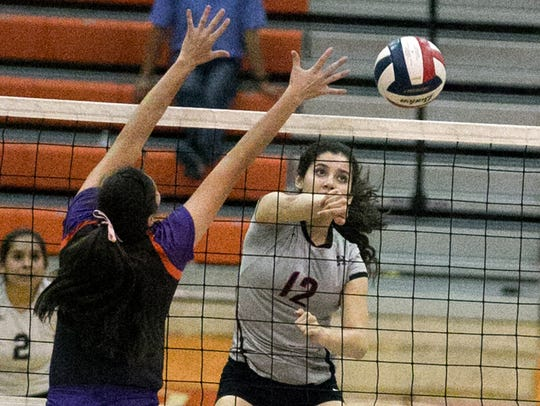 Sandra Sierra, 12, of Hanks gets a shot past Megan