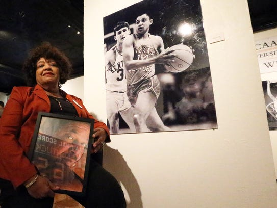Tina Hill holds a portrait of her late husband, former