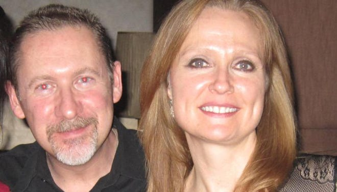 Sarah Bajc, 48, and her partner, Philip Wood, 50, an IBM executive from Texas. Wood was a passenger on Malaysia Airlines Flight 370.