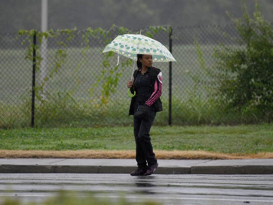 A woman crosses Interstate near Shelby in the rain