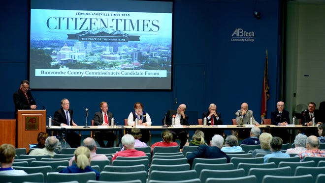 Candidates for county commission await their turns to speak at an Asheville Citizen-Times Buncombe County Commissioners Candidate Forum at the Ferguson Auditorium on the campus of Asheville-Buncombe Technical Community College on Thursday, Sept. 22, 2016.