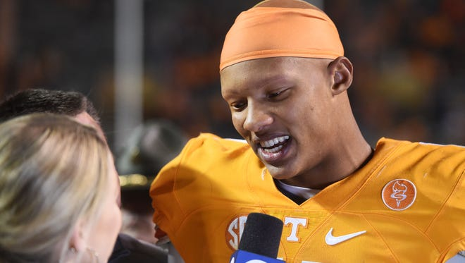 Tennessee quarterback Joshua Dobbs (11)speaks to the media after beating Missouri 63-43 in Neyland Stadium in Knoxville Saturday, Nov. 19, 2016.