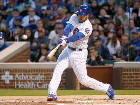 Chicago Cubs' Ben Zobrist hits an RBI single off Milwaukee Brewers starting pitcher Chase Anderson, scoring Kyle Schwarber, during the first inning of a baseball game, Monday, April 17, 2017, in Chicago. (AP Photo/Charles Rex Arbogast)