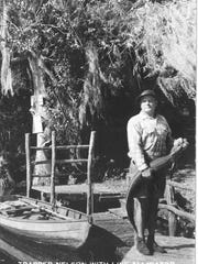 """Trapper (Vince) Nelson"" is shown holding a live alligator in this archival photo."