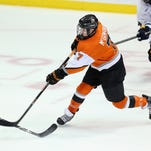 RIT goalie Jordan Ruby makes a stop with his blocker against Canisius.