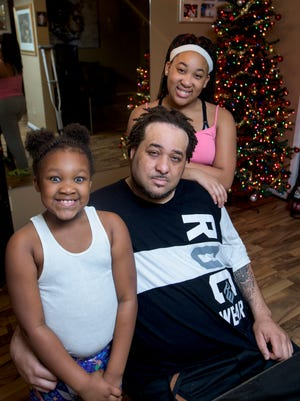 Michael Browder and his daughters Jacqualine, left, and Mikyla at their home in Montgomery, Ala. on Tuesday November 29, 2016.