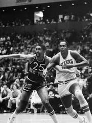 Knicks center Bill Cartwright (25) guarding 76ers center Moses Malone during first period NBA Semifinal playoff action, April 24, 1983, in Philadelphia.