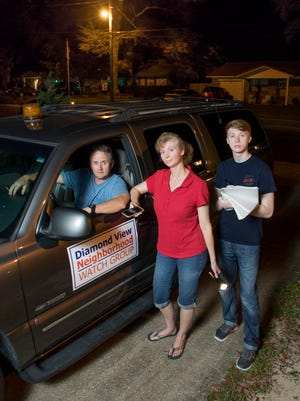 Russell, Linda and Wesley Warrick are members of the Diamond View Neighborhood Watch Group who go on regular patrols to observe suspicious activities, make reports to law enforcement, and to help keep crime down in their Pensacola neighborhood.  Friday, June 2, 2017.