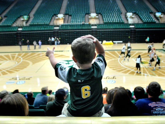 A young fan watches a scrimmage at Moby Arena.