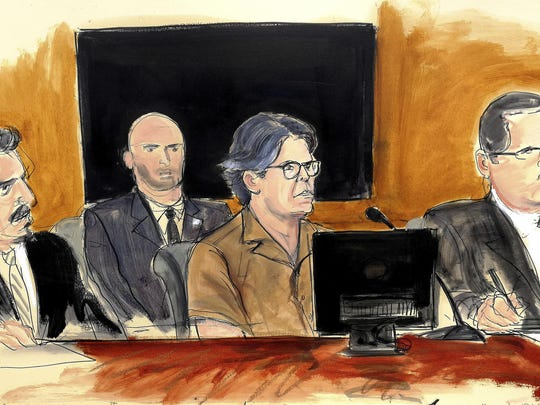 In this April 13 courtroom sketch, Keith Raniere, center, leader of the secretive group NXIVM, attends a court hearing in the Brooklyn borough of New York.