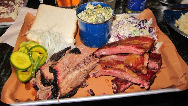 """A two-meat """"Big Cheeks"""" platter with pork ribs and beef brisket comes with broccoli cheese casserole and rough cut cole slaw."""