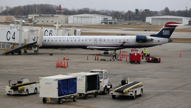 A U.S. Airways Express jet sits at the gate at the Des Moines airport.