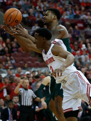 Michigan State forward Nick Ward, top, works for a rebound against Ohio State guard C.J. Jackson during the first half of MSU's 80-64 loss on Sunday, Jan. 7, 2018, in Columbus, Ohio.
