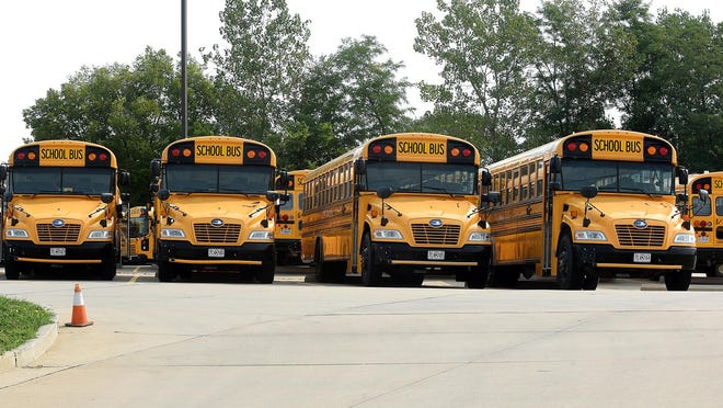 Student Transportation of America school buses sit idle on Tuesday at the bus barn on east Clark Lane as Columbia Public School's first day of online learning begins.