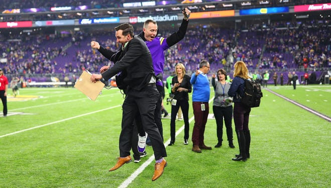 Former Firefly Music Festival head Greg Bostrom (left) and with DJ Skee celebrate the Minnesota Vikings' win over the New Orleans Saints on Jan. 14.