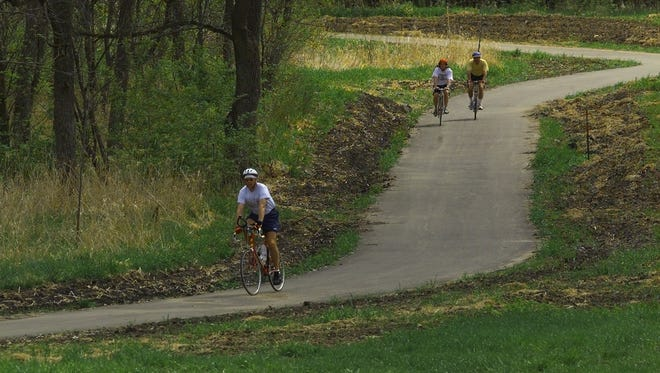 Cyclists ride part of the Raccoon River Valley Trail in Clive.