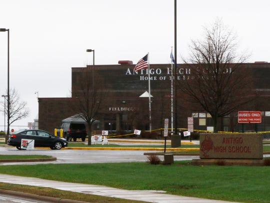 Yellow tape stands around Antigo High School during