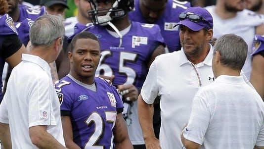 Baltimore Ravens running back Ray Rice, second from left, speaks with team leaders after a training camp practice earlier in July. The NFL suspended him for two games over domestic violence charges.