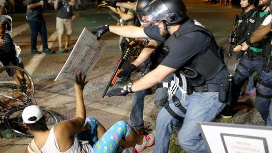 Police officers arrest a demonstrator on Aug. 18 in Ferguson, Missouri.