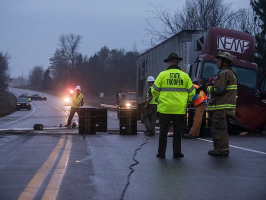 Vermont State Police investigate the scene of a fatal crash involving a tractor trailer and a car that killed one person on U.S. 7 in Shelburne early Thursday morning.