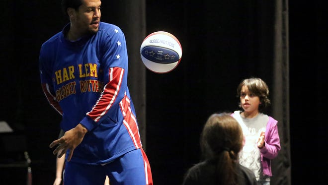 "Orlando ""El Gato"" Meléndez from the Harlem Globetrotters does a trick as he talks to students from Metro Elementary School about the team's ABCs of bullying prevention to help cut down on bullying Wednesday, Dec. 14, 2016, in Corpus Christi. Meléndez and the Globetrotters return Jan. 1."