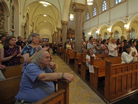 Residents attend Tuesday's mass at St. John Bosco Parish